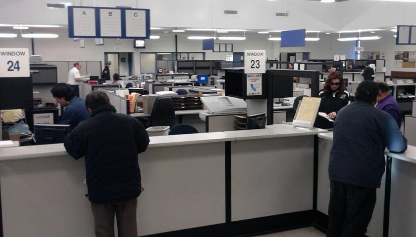 People at windows of DMV