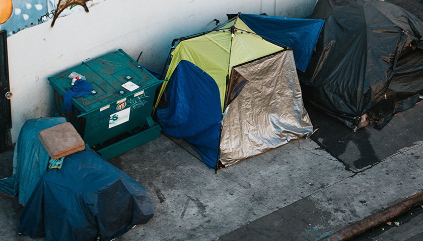 Group of tents on a sidewalk; homeless people