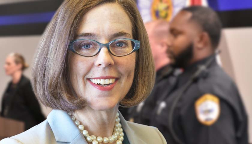 Police Officers, Firefighters Sue Oregon Governor Over COVID-19 Vaccine Mandates