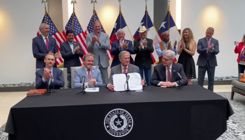 Abbott Signs Texas' Voting Reform Bill into Law, Ending Intense Political Fight