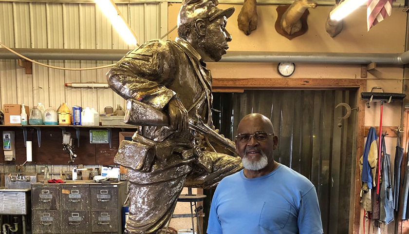 Man standing next to Joe Howard Statue to be put in Franklin, TN